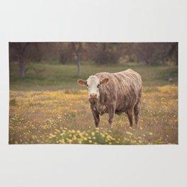 Cow in Wildflower Field Rug