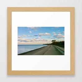 Clouds over the lakefront Framed Art Print