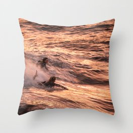 Girls catching a wave together Throw Pillow