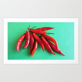 Spicy Red Hot Peppers on Green Background Art Print