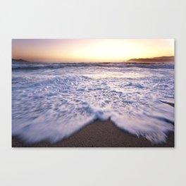 Waves at a beach Canvas Print