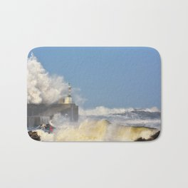 Stormy wave over lighthouse and pier of San Esteban de Pravia Bath Mat
