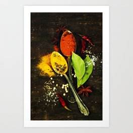 Bright spices on an old  wooden board Art Print