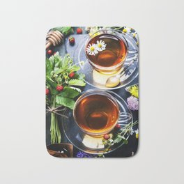 Herbal tea with honey, wild berry and flowers on wooden background Bath Mat
