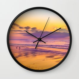Sunrise colors reflecting in wet sand Wall Clock