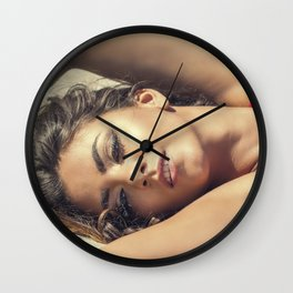 Portrait of sexy beautiful woman lying in the sand Wall Clock