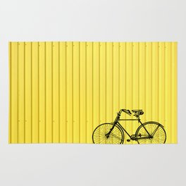 Vintage bike on yellow Rug