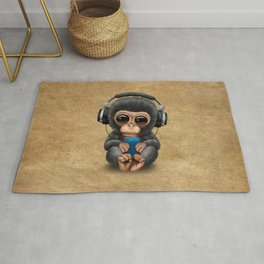 Baby Chimpanzee with Headphones Holding a Cell Phone Rug