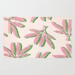 Botanic Leaf Pattern in pink and green over light pink background Rug