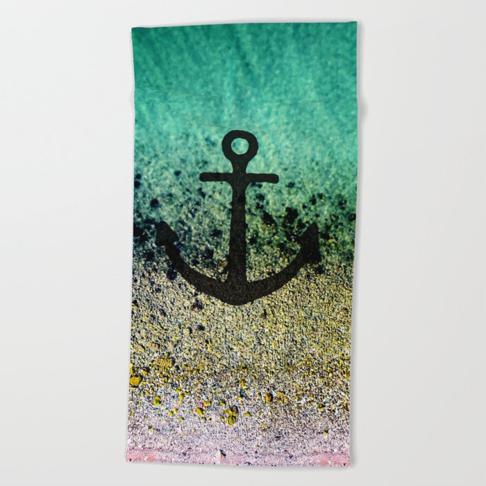 Anchored to the shore Beach Towel