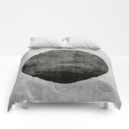 Concrete with black circle Comforters