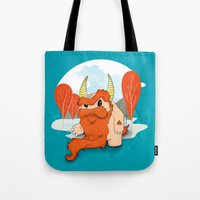 pixies Tote Bags featuring Graggy, the plump Happy Chaos Monster of Scotland by Roxie Rose Design