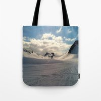 iceland Tote Bags featuring Snowcapped Iceland by tyler Guill