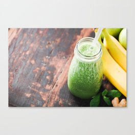 Close-up of green fresh smoothie with fruits, berries, oats and seeds, selective focus. Canvas Print