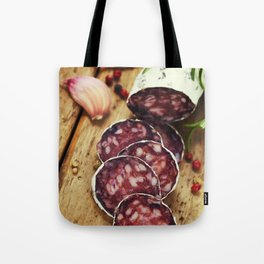 Close-up traditional sliced meat sausage salami on wooden board Tote Bag