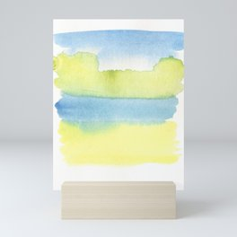 blue and yellow Mini Art Print