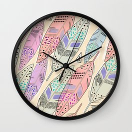 The feathers are multicolored on a beige background . Wall Clock
