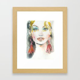 Woman with red earrings Framed Art Print