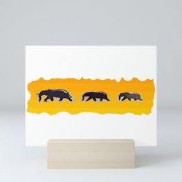 Elephants walking in the savanah Mini Art Print