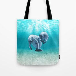 Two Manatees Swimming Tote Bag