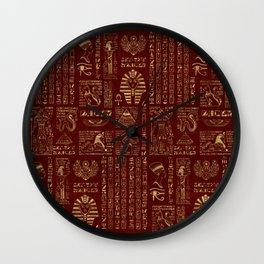 Egyptian hieroglyphs and symbols gold on red leather Wall Clock