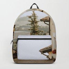 GAZEBO OUTSIDE WHITE PAINTED BUILDING Backpack