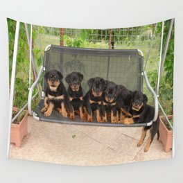 Six Rottweiler Puppies Lined Up On A Swing Wall Tapestry
