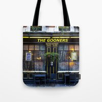 arsenal Tote Bags featuring The Gooners by David Pyatt