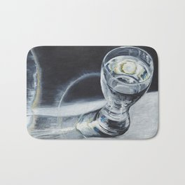 Glass of the water in the light Bath Mat