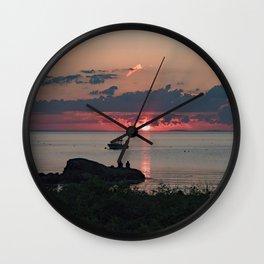 Sunset on the rocks Wall Clock
