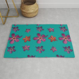 """Coral, pink & orange Violets over a teal background"" Rug"