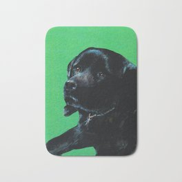 Black lab on green Bath Mat