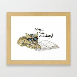 Kitten reading...shh Framed Art Print