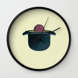 A single plum floating in perfume served in a man's hat. Wall Clock