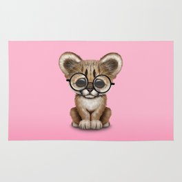 Cute Cougar Cub Wearing Reading Glasses on Pink Rug
