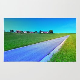 Small country road and a hill Rug