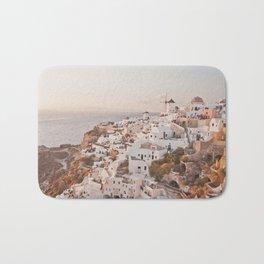 Santorini golden sunset, white houses, dome churches, reflection Bath Mat