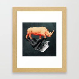 The orange rhinoceros who wanted to become a zebra Framed Art Print