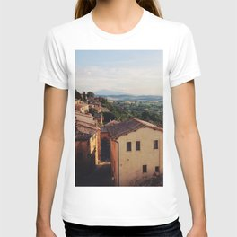 BROWN CONCRETE HOUSES ON MOUNTAIN AT DAYTIME T-shirt