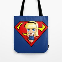 supergirl Tote Bags featuring Chibi Supergirl by artwaste