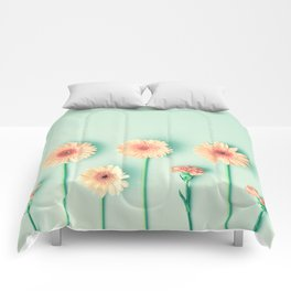composition of gerbers/daisies over mint Comforters
