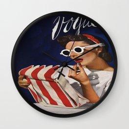Woman putting on lipstick Wall Clock