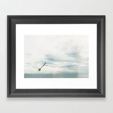 Bird Flies Over the Ocean Framed Art Print