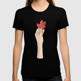 Holding the autumn T-shirt