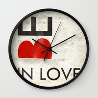 onesie Wall Clocks featuring BE IN LOVE by Lulla