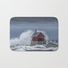 Grand Haven Lighthouse in a November Storm on Lake Michigan Bath Mat
