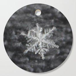 Snowflake on fuzzy sweater Cutting Board