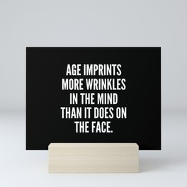 Age imprints more wrinkles in the mind than it does on the face Mini Art Print