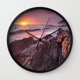 Sunset over the ocean in Garden Route NP, South Africa Wall Clock