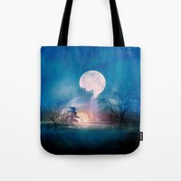 sun and moon Tote Bags featuring Moon Above, Sun Below by Viviana Gonzalez